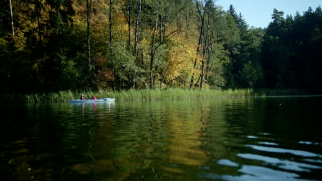 mother and son kayaking on a lake - non urban scene stock videos & royalty-free footage
