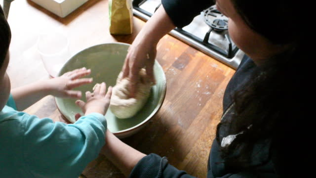 mother and son kneading dough - cooking stock videos & royalty-free footage