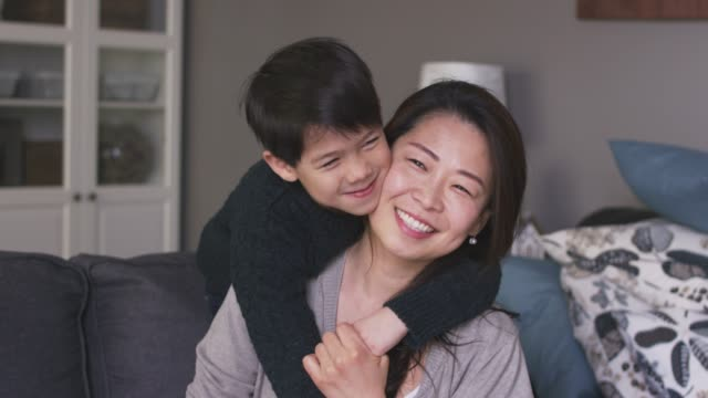 a mother and son laughing together - mother's day stock videos & royalty-free footage