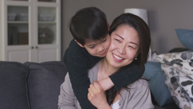 a mother and son laughing together - cosy stock videos & royalty-free footage