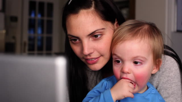 CU Mother and son (12-23 months) looking at computer / Brussels, Brabant, Belgium