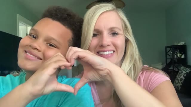 mother and son make heart hands together and blow kisses at their webcam - affectionate stock videos & royalty-free footage