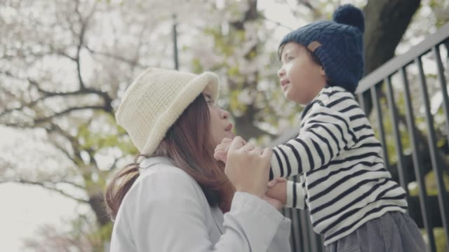 mother and son on beautiful spring day - cherry tree stock videos & royalty-free footage