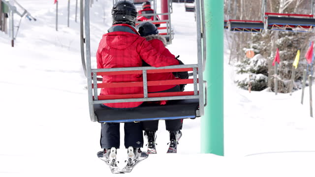 mother and son on ski lift in winter - ski holiday stock videos & royalty-free footage
