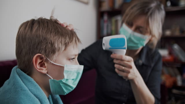 mother and son on telemedicine video call with doctor - positive emotion stock videos & royalty-free footage