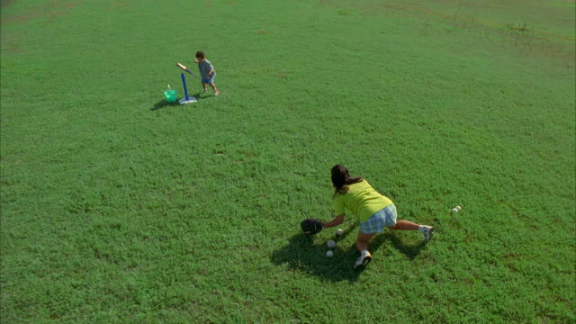 ws cs slo mo mother and son playing baseball / canyon lake, texas, usa - canyon lake stock videos & royalty-free footage