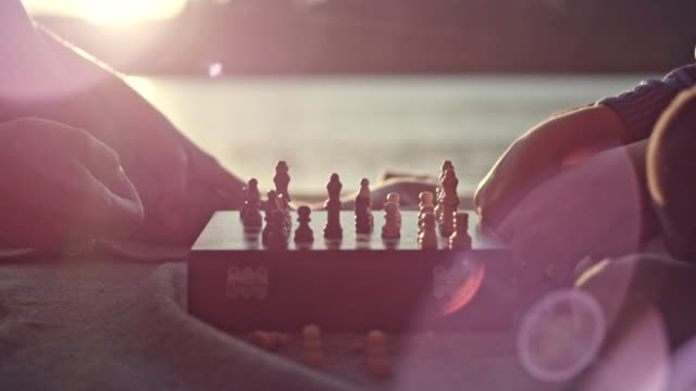 mother and son playing chess on a lake pier - chess stock videos & royalty-free footage