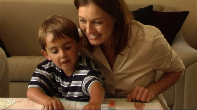 mother and son playing game - writing instrument stock videos & royalty-free footage