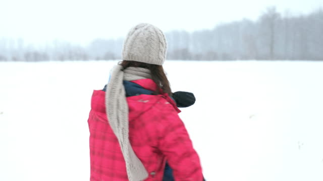 mother and son playing outdoor in winter snowstorm - baby boys stock videos & royalty-free footage