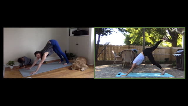 mother and son practice yoga with an online instructor - sun salutation stock videos & royalty-free footage