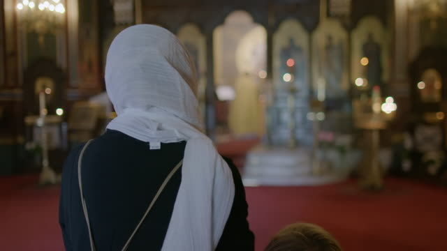 MS Mother and son praying in Saint Alexander Nevsky Cathedral / Paris, France