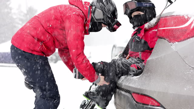 mother and son preparing for ski during covid-19 pandemic - ski holiday stock videos & royalty-free footage