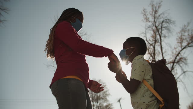 mother and son putting on masks before they go to school - braided hair stock videos & royalty-free footage