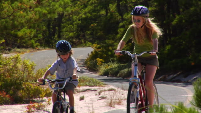 MS, Mother and son (4-5) riding bikes, Provincetown, Massachusetts, USA