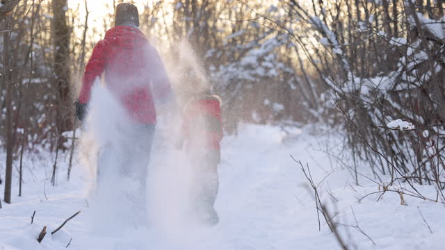 mother and son running with snowshoes in powder snow outdoors in winter - cold temperature stock videos & royalty-free footage
