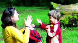 Mother and son singing in the forest