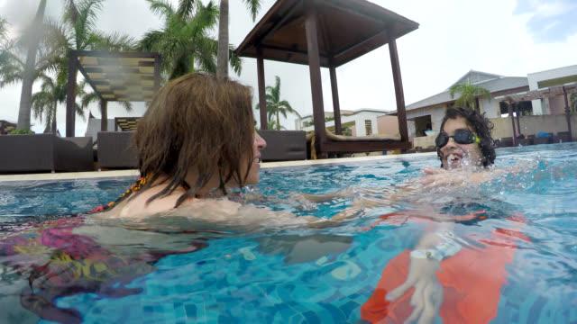 mother and son swimming at tourist resort, cayo santa maria, cuba - utebassäng bildbanksvideor och videomaterial från bakom kulisserna