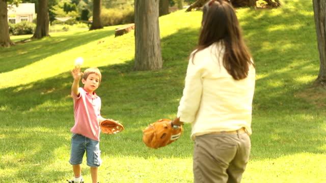 Mother and Son throw Baseball