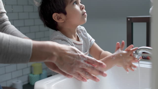 mother and son washing hands - 30 seconds or greater stock videos & royalty-free footage