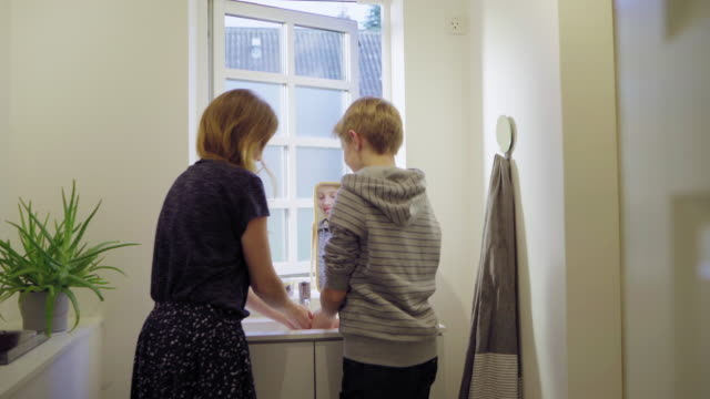 mother and son washing hands - bathroom sink stock videos & royalty-free footage
