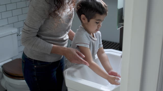 mother and son washing hands - less than 10 seconds stock videos & royalty-free footage
