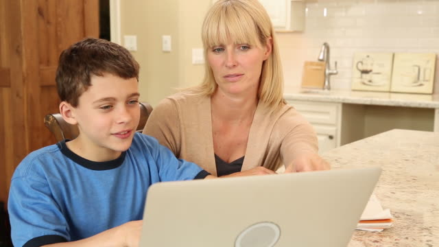 mother and son working on a laptop computer - 2014 stock videos and b-roll footage