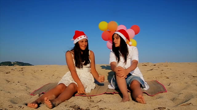 Mother and teenage daughter Celebrate Christmas holiday on the beach