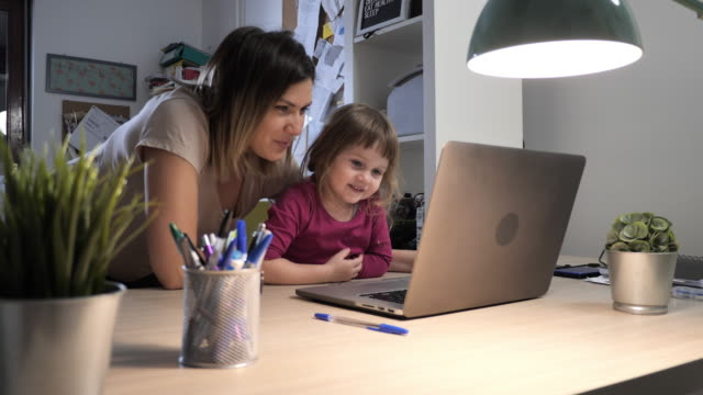 mother and toddler playing together on laptop - family with one child stock videos & royalty-free footage