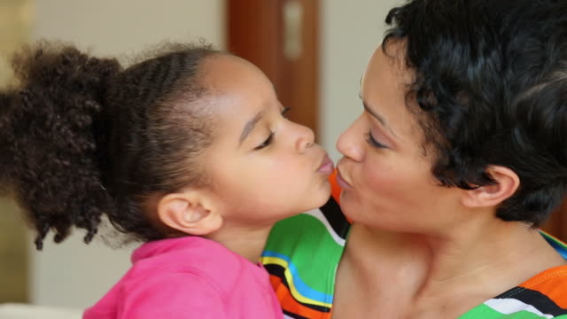 ms mother and young daughter hugging and kissing / richmond, virginia, usa - zungenkuss stock-videos und b-roll-filmmaterial