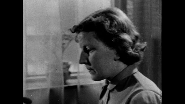 stockvideo's en b-roll-footage met 1946 - mother and young son - 1946