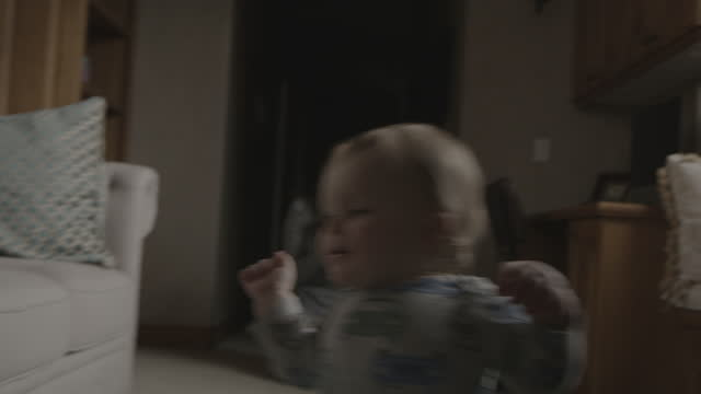 mother applauding approaching baby boy taking first steps / cedar hills, utah, united states - stepping stock videos & royalty-free footage