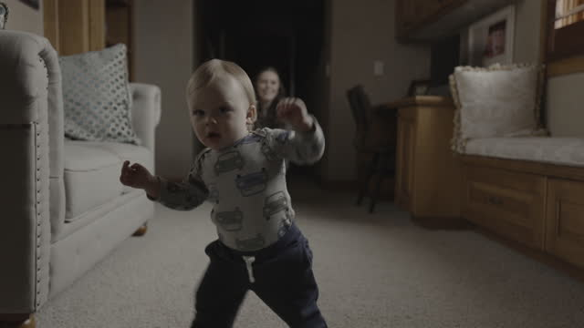mother applauding approaching baby boy taking first steps / cedar hills, utah, united states - full length stock videos & royalty-free footage