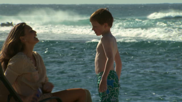 mother applying sunscreen to son at beach - see other clips from this shoot 1141 stock videos & royalty-free footage