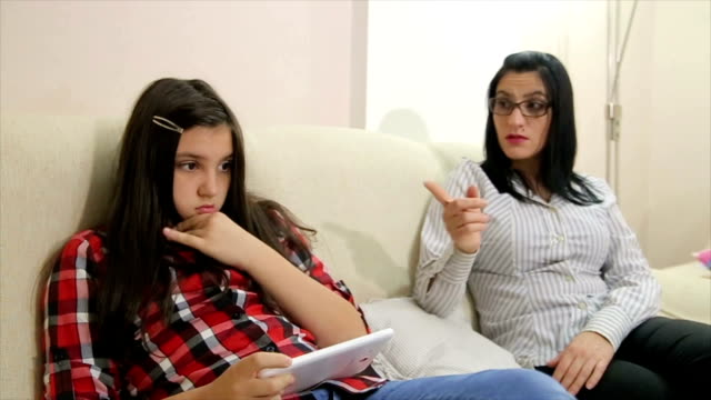 mother arguing with daughter over use of mobile phone - disappointment stock videos & royalty-free footage