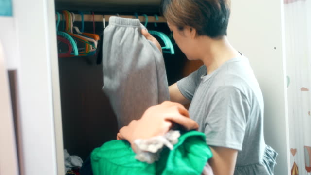 mother arranges her daughter's clothes - tidy room stock videos & royalty-free footage