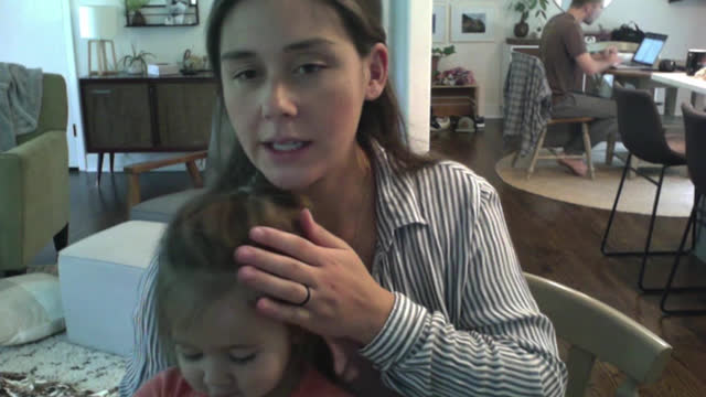 mother at home with her young daughter sits in front of computer during video call - conference call stock videos & royalty-free footage