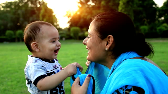 mother & baby playing in the park - indian mom stock videos & royalty-free footage