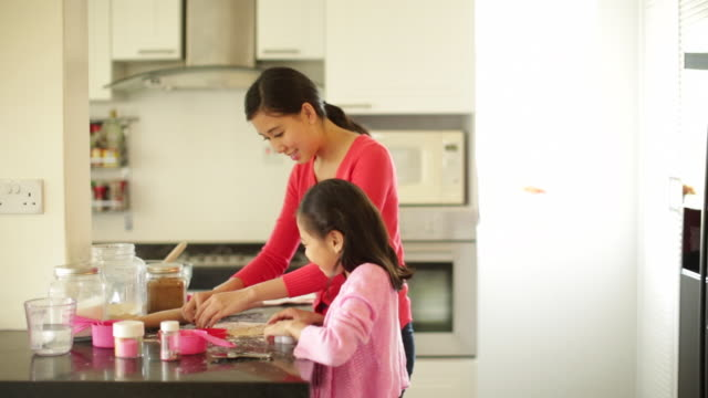 MS Mother baking cookies with her daughter