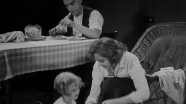 1930 montage mother bathing child in washtub in family room with husband sitting at table / united kingdom - bath stock videos and b-roll footage