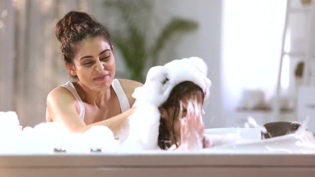 mother bathing her daughter in bathtub, delhi, india - taking a bath stock videos & royalty-free footage