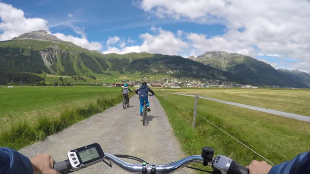mother biking with the kids in switzerland - central europe stock videos and b-roll footage