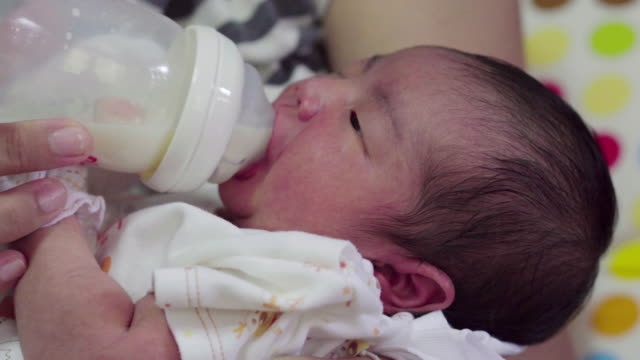 mother bottle feeding baby - hugging self stock videos & royalty-free footage