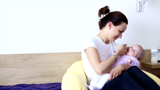 hd: mother bottle-feeding her baby - milk bottle stock videos & royalty-free footage