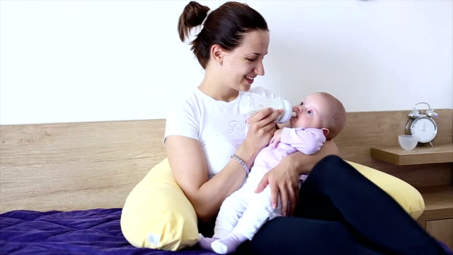 hd: mother bottle-feeding her baby - milk bottle stock videos & royalty-free footage