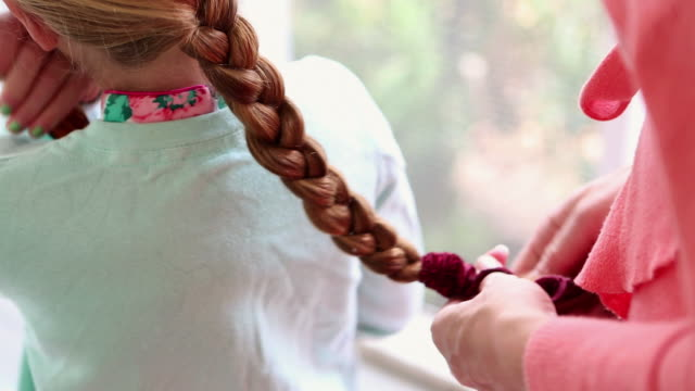 ms mother braiding her daughter hair / st. simon's island, georgia, united states - braided hair stock videos & royalty-free footage