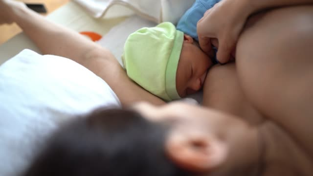 mother breastfeeding a newborn baby boy - childbirth stock videos & royalty-free footage