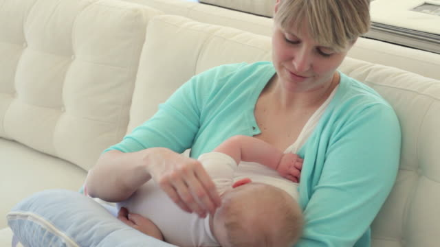 ms pan mother breastfeeding baby boy (2-5 months) on sofa / richmond, virginia, usa - 2 5 months stock videos & royalty-free footage