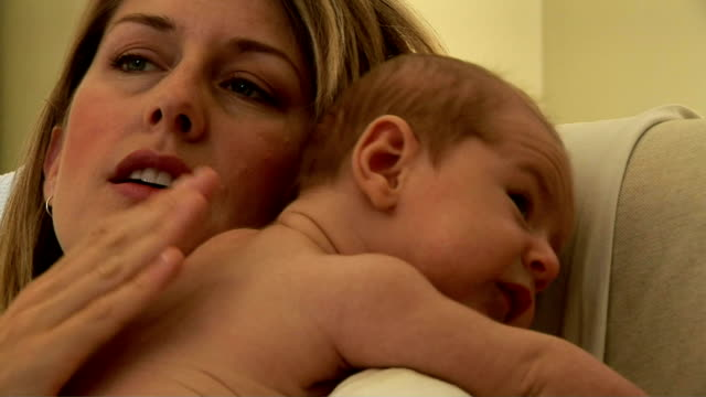 mother burbing baby - burping stock videos & royalty-free footage
