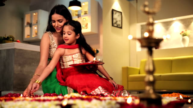 Mother celebrating diwali festival with her daughter, Delhi, India
