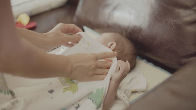 mother changing diaper to her baby boy - nappy bag stock videos & royalty-free footage